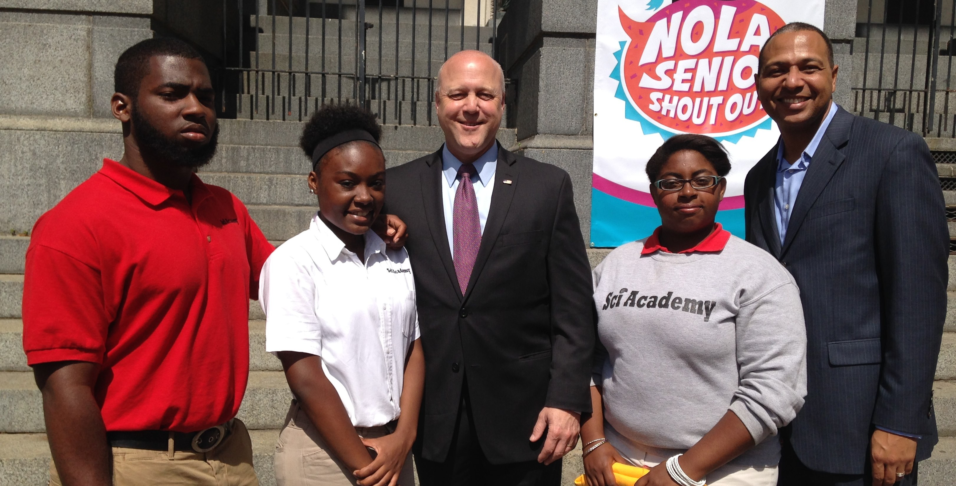 College-bound seniors pose with New Orleans Mayor Mitch Landrieu (center) and RSD Supt. Patrick Dobard (right).