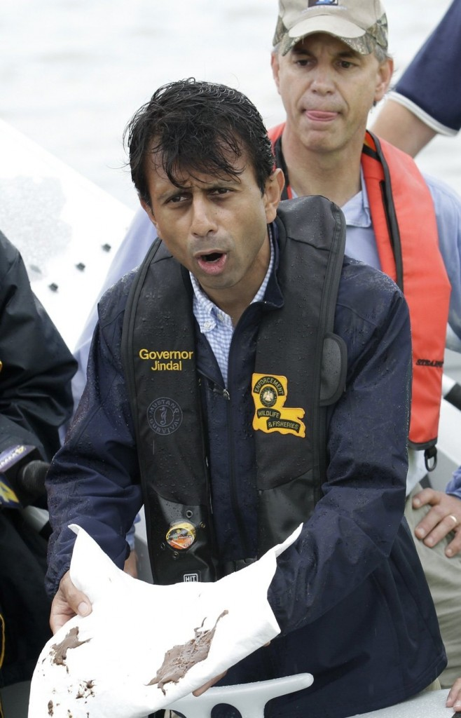 Bobby Jindal shows reporters the mess he's created.