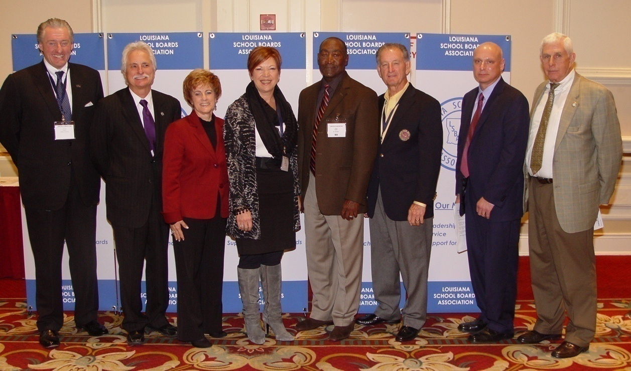 Thick as thieves: LFT President Steve Monaghan (2nd from left), former LAE President Debbie Meaux (3rd from left), former Louisiana Association of School Superintendents President Patrice Pujol (4th from left), LSBA Executive Director Scott Richard (2nd from right) and anti-CCSS legislator J. Rogers Pope (right).